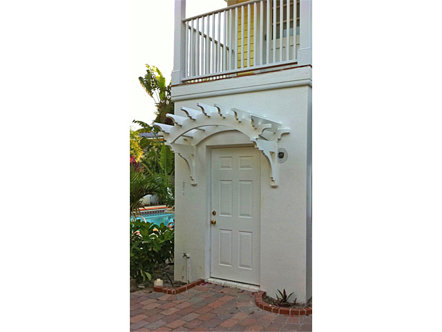 Custom trellis above door